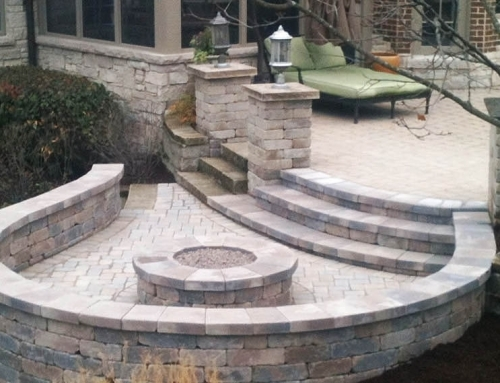 Multi level patio area with steps, fire place, and feature walls