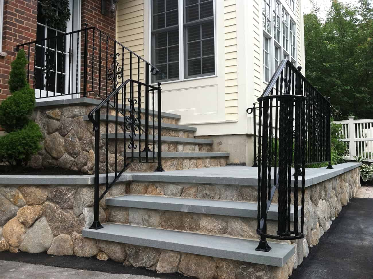 Natural stone steps leading to house entrance