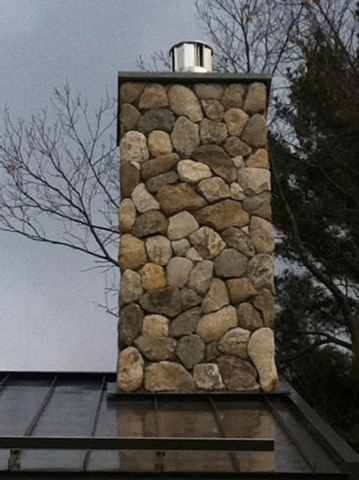 Chimney rebuilt with natural rocks