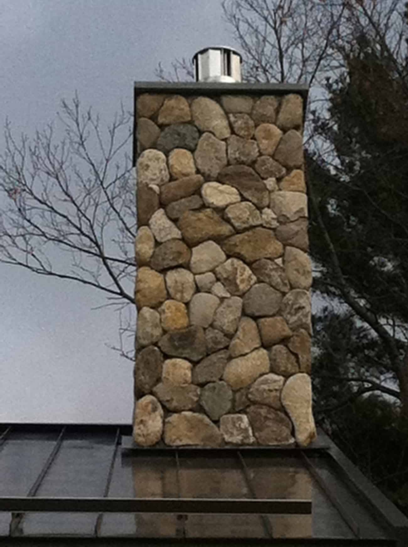 Chimney rebuilt with natural rocks