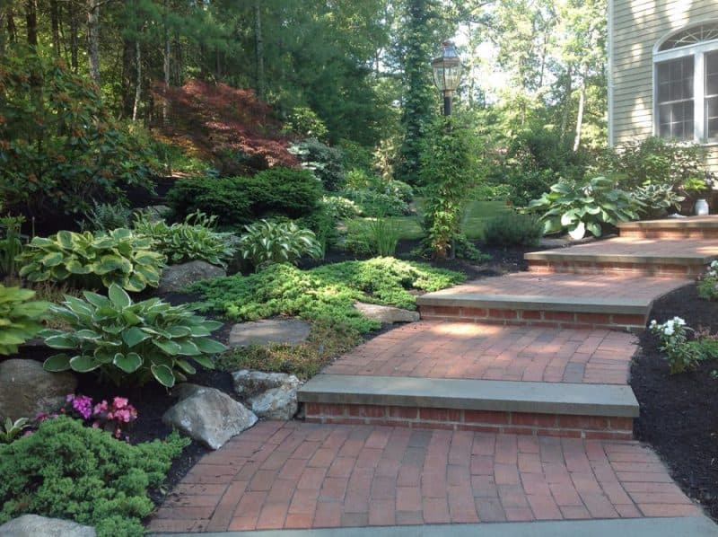Brick pathway through landscaped slope