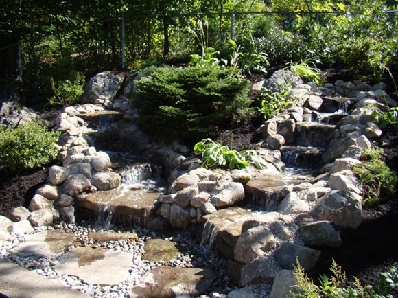 Water cascading into a Pond made of Natural Stone