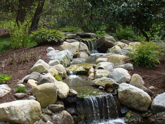 Water Feature with Stream bordered by Rocks