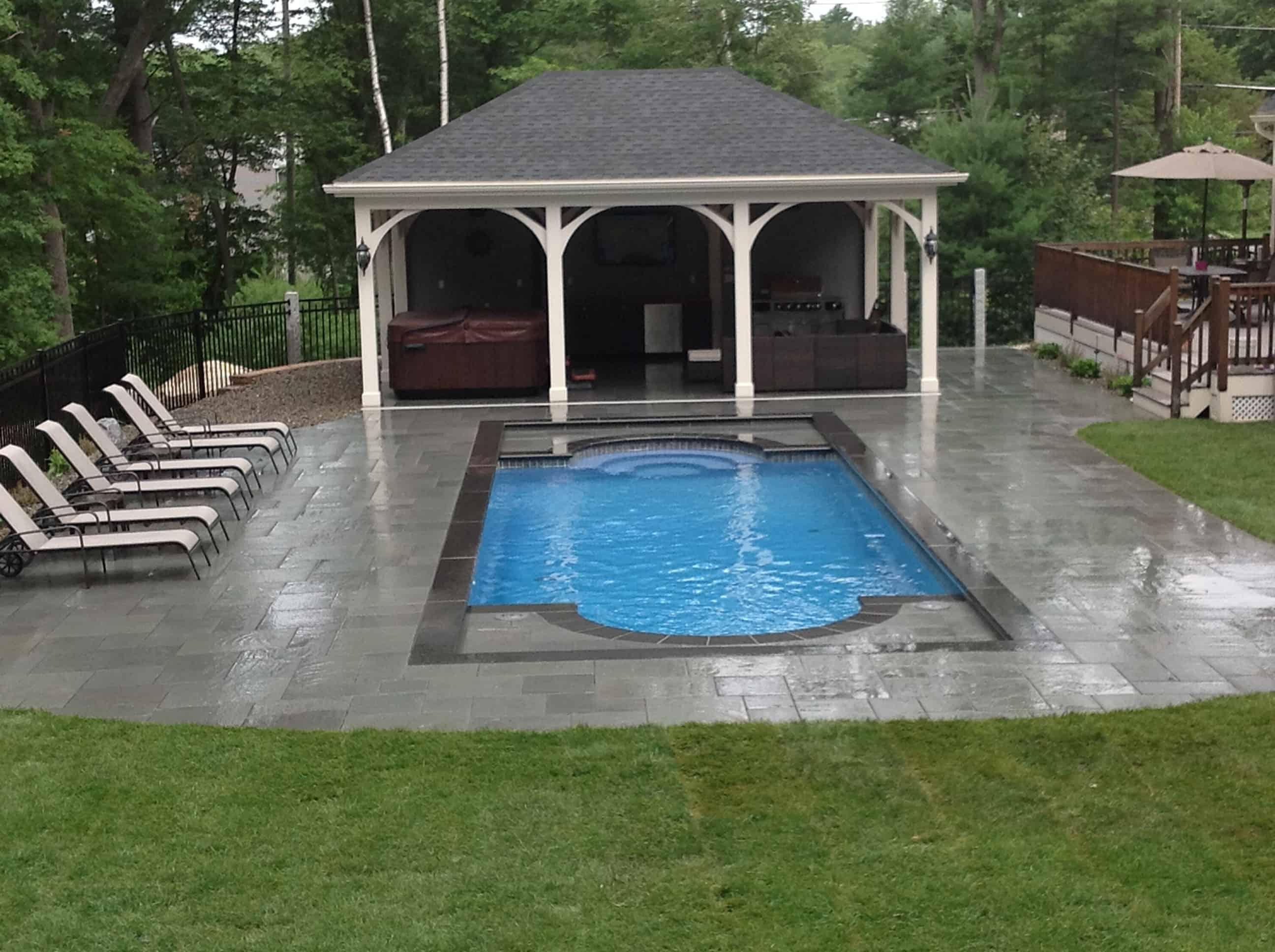 Hardscaped area around and Inground Pool